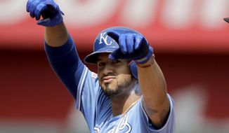 Kansas City Royals' Cheslor Cuthbert celebrates on second after hitting a two-run double during the fifth inning of a baseball game against the Oakland Athletics Thursday, Aug. 29, 2019, in Kansas City, Mo. (AP Photo/Charlie Riedel)