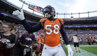 Denver Broncos outside linebacker Von Miller (58) gives a thumbs up tp fans prior to an NFL preseason football game against the Arizona Cardinals, Thursday, Aug. 29, 2019, in Denver. (AP Photo/Jack Dempsey)
