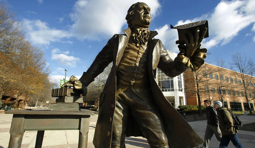 """In this Tuesday, Dec 14, 2010 file photo, a statue of George Mason stands in the heart of George Mason University's Fairfax campus in Fairfax, Va.  Newly released documents show that a $50 million gift to Virginia's largest public university was given specifically to """"promote the conservative principles of governance,"""" raising concerns from critics that that it compromises academic freedom. (AP Photo/Manuel Balce Ceneta, File)"""