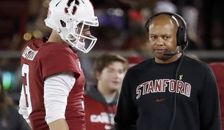 FILE - In this Aug. 31, 2018, file photo, Stanford quarterback K.J. Costello (3) talks to head coach David Shaw, right, during the second half of an NCAA college football game against San Diego State in Stanford, Calif. Shaw enters every season with a level of curiosity about how everything he's seen in spring ball and fall camp will transfer over to the season. (AP Photo/Tony Avelar, File)