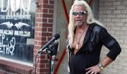 """This Aug. 2, 2019 file photo shows Duane """"Dog the Bounty Hunter"""" Chapman talking to reporters outside his storefront that was burglarized in Edgewater, Colo. (AP Photo/David Zalubowski, File)"""