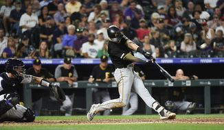Pittsburgh Pirates' Kevin Newman, right, hits his second home run of the night in the fifth inning of a baseball game against the Colorado Rockies, Thursday, Aug. 29, 2019, in Denver. (AP Photo/John Leyba)