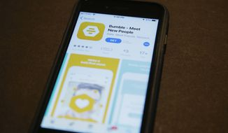 A phone with an App Store selection of the dating app Bumble is pictured Thursday, Aug. 29, 2019, in Oklahoma City. Texas is gearing up to be a leader on cracking down on people who send unwanted nude images. The state's new law that bans so-called cyber flashing is set to take effect on Saturday. It comes after dating app company Bumble lobbied for action in Texas earlier this year. (AP Photo/Sue Ogrocki)