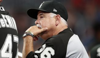Chicago White Sox manager Rick Renteria watches from the dugout during the seventh inning of a baseball game against the Atlanta Braves, Friday, Aug. 30, 2019, in Atlanta. (AP Photo/John Bazemore)