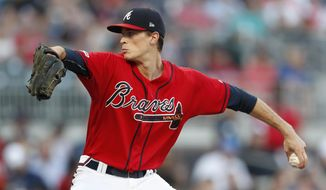 Atlanta Braves starting pitcher Max Fried works in the first inning of a baseball game against the Chicago White Sox, Friday, Aug. 30, 2019, in Atlanta. (AP Photo/John Bazemore)