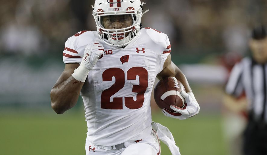 Wisconsin running back Jonathan Taylor (23) scores on a 37-yard tun against South Florida during the first half of an NCAA college football game Friday, Aug. 30, 2019, in Tampa, Fla. (AP Photo/Chris O'Meara)
