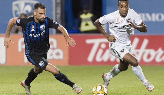 D.C. United's Ola Kamara, right, breaks away from Montreal Impact's Rudy Camacho during the second half of an MLS soccer match Saturday, Aug. 31, 2019, in Montreal. (Graham Hughes/The Canadian Press via AP) ** FILE **