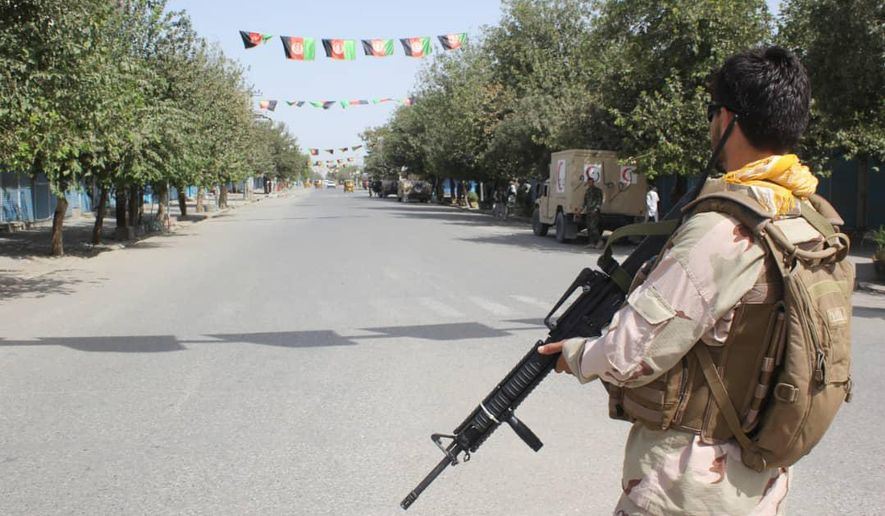 Afghan security forces stand guard during a fight against Taliban fighters in Kunduz province north of Kabul, Afghanistan, Saturday, Aug. 31, 2019. The Taliban have launched a new large-scale attack on one of Afghanistan's main cities, Kunduz, and taken hospital patients as hostages, the government said Saturday, even as the insurgent group continued negotiations with the United States on ending America's longest war. (AP Photo/Bashir Khan Safi)