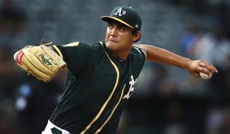 FILE - In this Aug. 13, 2018, file photo, Oakland Athletics pitcher Sean Manaea works against the Seattle Mariners in the first inning of a baseball game in Oakland, Calif. Manaea is scheduled to start Sunday, Sept. 1, 2019, for the Oakland at Yankee Stadium, his season debut after recovering from left shoulder surgery. (AP Photo/Ben Margot, File)