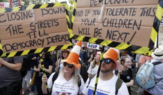 Anti Brexit protesters from 'Stop the Coup' movement demonstrate outside Downing Street in London, Saturday, Aug. 31, 2019. Political opposition to Prime Minister Boris Johnson's move to suspend Parliament is crystalizing, with protests around Britain and a petition to block the move gaining more than 1 million signatures. (AP Photo/Alastair Grant)