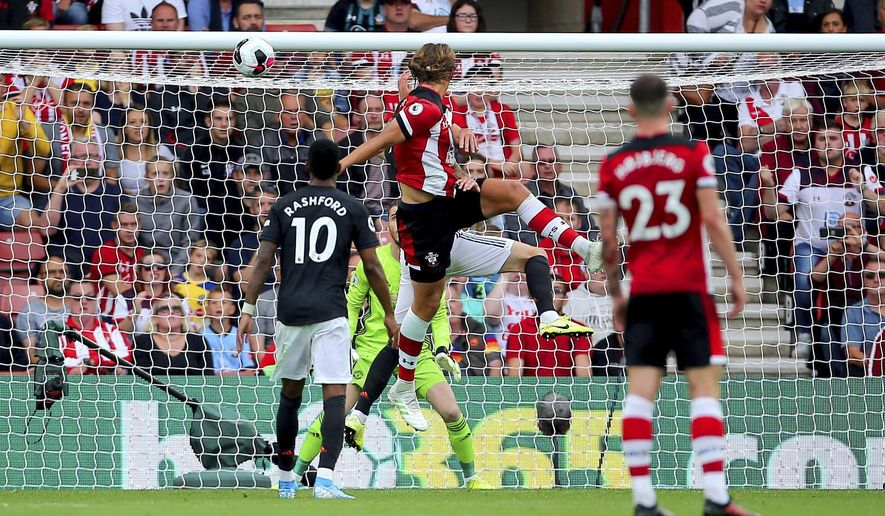 Southampton's Jannik Vestergaard, center, scores his side's first goal of the game during the English Premier League soccer match at St Mary's, Southampton, England, Saturday Aug. 31, 2019. (Mark Kerton/PA via AP)
