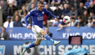 Leicester City's Jamie Vardy scores against Bournemouth during the English Premier League soccer match at the King Power Stadium, Leicester, England, Saturday Aug. 31, 2019. (Tim Goode/PA via AP)
