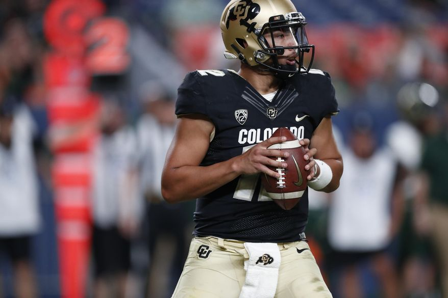 Colorado quarterback Steven Montez looks to pass the ball against Colorado State in the fourth quarter of an NCAA college football game Friday, Aug. 30, 2019, in Denver. Colorado won 52-31. (AP Photo/David Zalubowski)