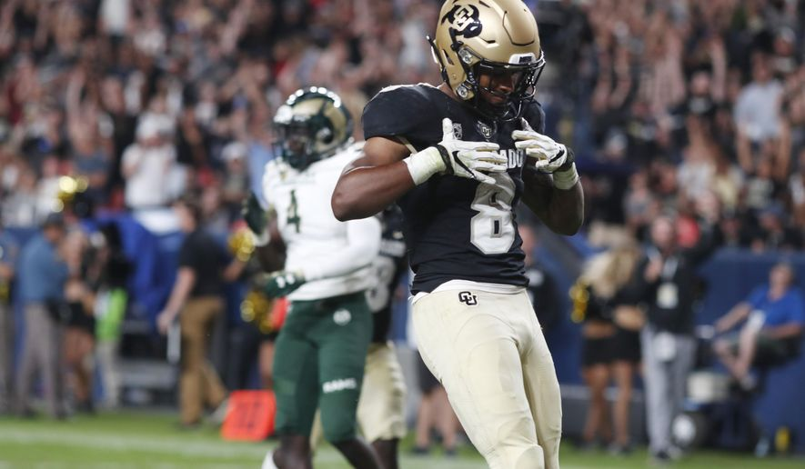 Colorado running back Alex Fontenot celebrates after his run for a touchdown against Colorado State during the third quarter of an NCAA college football game Friday, Aug. 30, 2019, in Denver. (AP Photo/David Zalubowski)