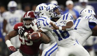 Duke quarterback Quentin Harris (18) throws from the pocket during the second half an NCAA college football game against Alabama, Saturday, Aug. 31, 2019, in Atlanta. Alabama won 42-3. (AP Photo/John Bazemore)