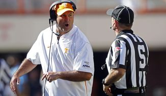 Tennessee head coach Jeremy Pruitt yells at side judge Eduardo Balbis in the first half of an NCAA college football game against Georgia State, Saturday, Aug. 31, 2019, in Knoxville, Tenn. (AP Photo/Wade Payne)