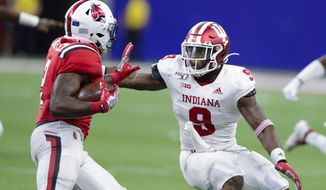 Indiana defensive back Marcelino Ball (9) tackles Ball State running back Caleb Huntley (2) during the second half of an NCAA college football game in Indianapolis, Saturday, Aug. 31, 2019. Indiana defeated Ball State 34-24. (AP Photo/Michael Conroy)