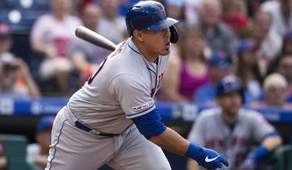 New York Mets' Wilson Ramos hits a single with one run batted in off of Philadelphia Phillies starting pitcher Jason Vargas during the first inning of a baseball game, Saturday, Aug. 31, 2019, in Philadelphia. (AP Photo/Matt Rourke)