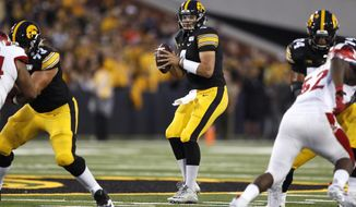 Iowa quarterback Nate Stanley, center, throws a pass during the first half of an NCAA college football game against Miami of Ohio, Saturday, Aug. 31, 2019, in Iowa City, Iowa. (AP Photo/Charlie Neibergall)