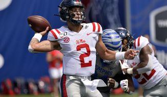 Mississippi quarterback Matt Corral (2) throws a pass in the first half of an NCAA college football game against Memphis, Saturday, Aug. 31, 2019, in Memphis, Tenn. (AP Photo/Brandon Dill)