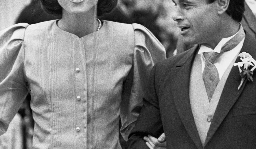 FILE - In this April 26, 1986 file photo, maid of Honor Caroline Kennedy and Best Man Franco Columbu, leave St. Francis Xavier Church after the wedding of Caroline's cousin Maria Shriver to Arnold Schwarzenegger in Hyannis, Mass.. Italian bodybuilder, boxer and actor Franco Columbu, one of Arnold Schwarzenegger's closest friends, has died aged 78. Columbu died in a hospital in his native Sardinia on Friday, Aug. 30, 2019 afternoon after being taken ill while he was swimming in the sea. (AP Photo/Mike Kullen, file)