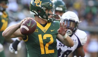 Baylor quarterback Charlie Brewer throws downfield against Stephen F. Austin in the first half of an NCAA college football game Saturday, Aug. 31, 2019, in Waco, Texas. (Rod Aydelotte/Waco Tribune-Herald via AP)