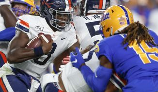 Virginia quarterback Bryce Perkins (3), left, runs as Pittsburgh defensive back Jason Pinnock (15) pursues in the first quarter of an NCAA college football game, Saturday, Aug. 31, 2019, in Pittsburgh. (AP Photo/Keith Srakocic)