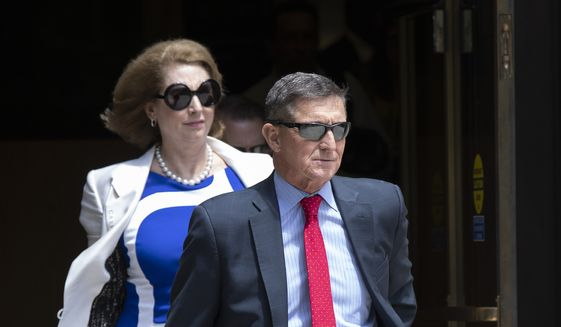 Former National Security Adviser Michael Flynn leaves the federal courthouse in Washington on Monday, June 24, 2019. Flynn's lawyer Sidney Powell is at left. (AP Photo/Manuel Balce Ceneta) ** FILE **
