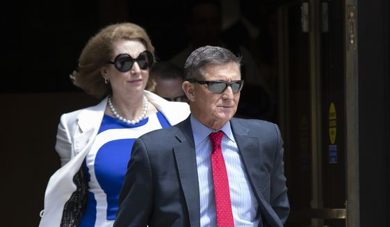 Former National Security Adviser Michael Flynn, leaves the federal courthouse in Washington, Monday, June 24, 2019. Flynn's lawyer Sidney Powell, is at left. (AP Photo/Manuel Balce Ceneta)