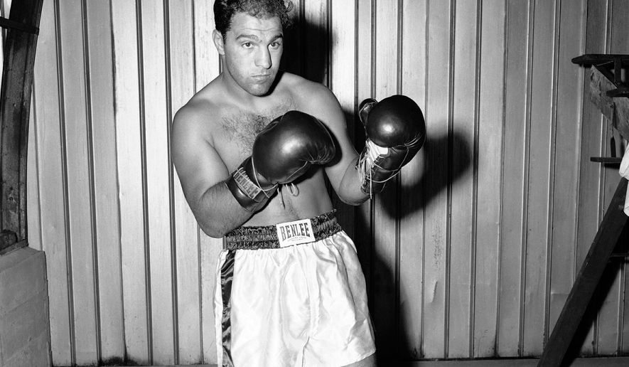 Rocky Marciano at Grossingers in New York for tale of the tape, August 31, 1955. (AP Photo)