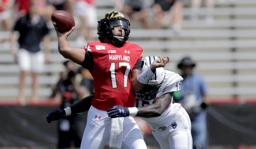 Maryland quarterback Josh Jackson, left, is hit by Howard defensive lineman Elton Jean-Baptiste while attempting a pass during the first half of an NCAA college football game, Saturday, Aug. 31, 2019, in College Park, Md. (AP Photo/Julio Cortez) **FILE**