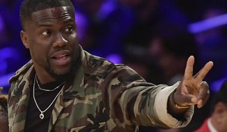 In this Jan. 29, 2019, file photo, actor Kevin Hart gestures during the second half of an NBA basketball game between the Los Angeles Lakers and the Philadelphia 76ers in Los Angeles. Hart has been injured in a car crash in the hills above Malibu on Sunday, Sept. 1. (AP Photo/Mark J. Terrill, File)