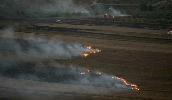 Flames and smoke rise from where Israeli army shells that landed in the southern Lebanese border village of Maroun Al-Ras, Lebanon, Sunday, Sept. 1, 2019. Hezbollah militants fire a barrage of anti-tank missiles into Israel, prompting a reprisal of heavy Israeli artillery fire, in one of the most intense rounds of fighting between the bitter enemies since a 2006 war. The sudden burst of violence, which ended after about two hours without any casualties reported on either side, nonetheless raised the prospect of an even wider round of fighting. (AP Photo/Mohammed Zaatari)