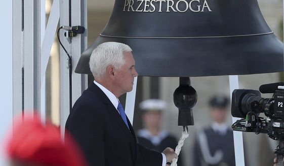 U.S. Vice President Mike Pence rings the Bell of Memory and Warning during a memorial ceremony marking the 80th anniversary of the start of World War II in Warsaw, Poland, Sunday, Sept. 1, 2019. (AP Photo/Czarek Sokolowski)