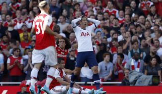 Tottenham's Son Heung-min reacts after missing a chance to score during their English Premier League soccer match between Arsenal and Tottenham Hotspur at the Emirates stadium in London, Sunday, Sept. 1, 2019. (AP Photo/Alastair Grant)
