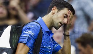 Novak Djokovic, of Serbia, walks off the court as he retires during his match against Stan Wawrinka, of Switzerland, during the fourth round of the U.S. Open tennis championships, Sunday, Sept. 1, 2019, in New York. (AP Photo/Eduardo Munoz Alvarez) ** FILE **