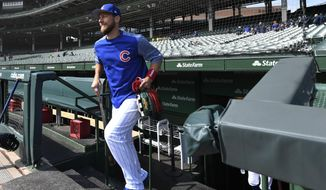 Chicago Cubs' Ben Zobrist returns to Wrigley Field for batting practice after being gone several months for personal reasons before a baseball game between the Chicago Cubs and Milwaukee Brewers Sunday, Sept. 1, 2019, in Chicago. (AP Photo/Paul Beaty)