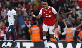 Arsenal's Pierre-Emerick Aubameyang, left, celebrates after scoring his side's second goal during their English Premier League soccer match between Arsenal and Tottenham Hotspur at the Emirates stadium in London, Sunday, Sept. 1, 2019. (AP Photo/Alastair Grant)