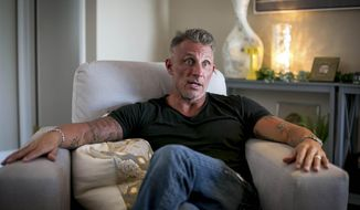 In this July 30, 2019 photo, Tullian Tchividjian, grandson of famed pastor Billy Graham, talks about his past struggles at his home in Jupiter, Fla. Tchividjian was defrocked from the South Florida Presbytery for sexual misconduct. He now leads a congregation that meets at a hotel, which is serving as a worship spot until they can find a permanent place. (Richard Graulich/Palm Beach Post via AP)
