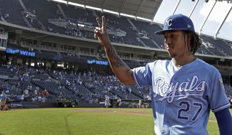 Kansas City Royals shortstop Adalberto Mondesi gestures to the crowd as he leaves the field after a baseball game against the Baltimore Orioles, Sunday, Sept. 1, 2019, in Kansas City, Mo. (AP Photo/Charlie Riedel)