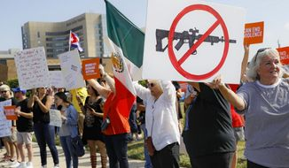 FILE - In this Aug. 7, 2019, file photo, demonstrators gather to protest after a mass shooting that occurred in Dayton, Ohio. (AP Photo/John Minchillo, File)