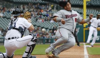 Minnesota Twins' Willians Astudillo, right, beats the throw to Detroit Tigers catcher Jake Rogers, left, to score from second on a single by teammate Jorge Polanco during the second inning of a baseball game, Sunday, Sept. 1, 2019, in Detroit. (AP Photo/Carlos Osorio)