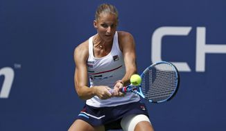 Karolina Pliskova, of the Czech Republic, returns to Johanna Konta, of the United Kingdom, during round four of the US Open tennis championships Sunday, Sept. 1, 2019, in New York. (AP Photo/Kevin Hagen)