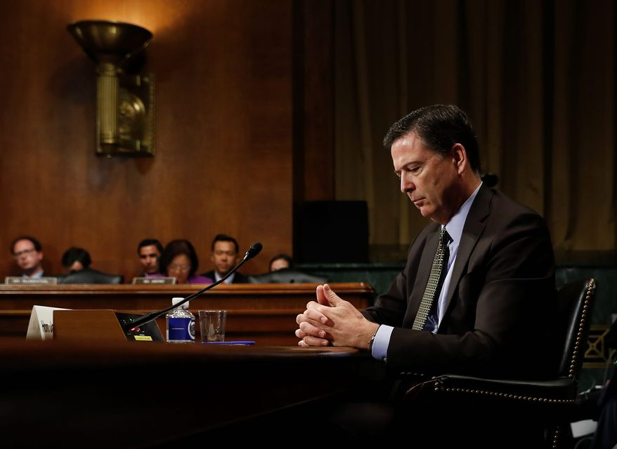In this Wednesday, May 3, 2017, photo, then-FBI Director James B. Comey pauses as he testifies on Capitol Hill in Washington, before a Senate Judiciary Committee hearing. (AP Photo/Carolyn Kaster) ** FILE **