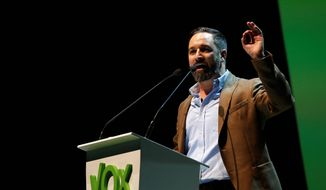 Santiago Abascal the national president of VOX delivers his speech during a rally of the fledging far-right party VOX in Madrid, Spain, Sunday, Oct. 7, 2018. Thousands of Spaniards have attended a rally of the fledging far-right party VOX as it tries to grab a foothold in Spain's political spectrum. (AP Photo/Manu Fernandez) ** FILE **