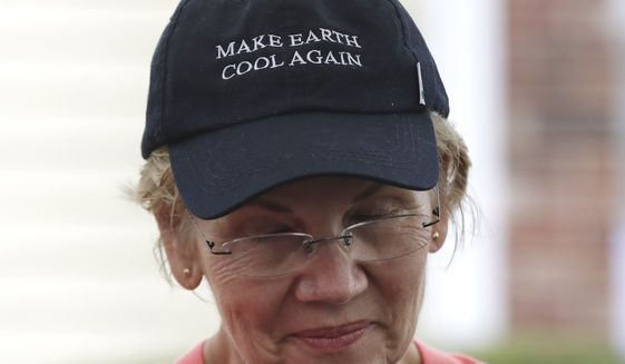 """Democratic presidential candidate Sen. Elizabeth Warren, D-Mass., wears a hat with the message """"Make Earth Cool Again"""" at a campaign event, Monday, Sept. 2, 2019, in Hampton Falls, N.H. (AP Photo/Elise Amendola)"""