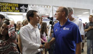 Democratic presidential candidate Pete Buttigieg talks with Chris Rolwes, of Cedar Rapids, Iowa, right, during the Hawkeye Area Labor Council Labor Day Picnic, Monday, Sept. 2, 2019, in Cedar Rapids, Iowa. (AP Photo/Charlie Neibergall)