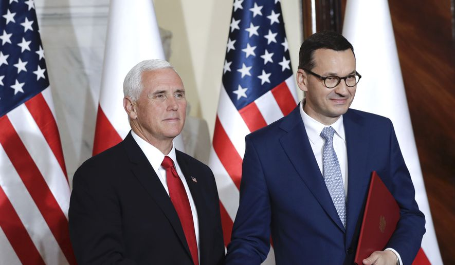 U.S. Vice President Mike Pence and Polish Prime Minister Mateusz Morawiecki, right, shake hands after signing an agreement in Warsaw, Poland, Monday, Sept. 2, 2019. The U.S. and Poland signed an agreement on Monday to cooperate on new 5G technology amid growing concerns about Chinese telecommunications giant Huawei. (AP Photo/Petr David Josek)