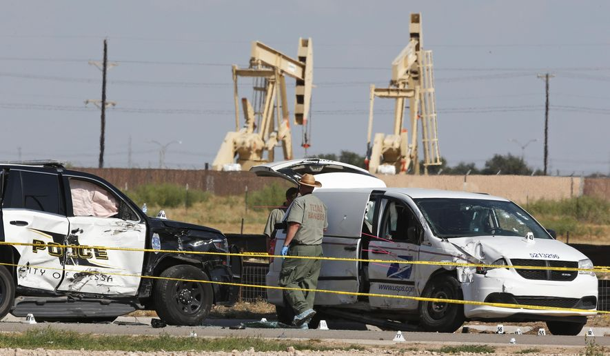 Law enforcement officials process the crime scene Sunday, Sept. 1, 2019, in Odessa, Texas, from Saturday's shooting which ended with the alleged shooter being shot dead by police in a stolen mail van, right. (AP Photo/Sue Ogrocki)