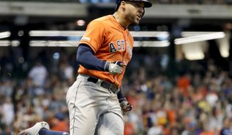 Houston Astros' George Springer reacts after hitting a home run during the 10th inning of a baseball game against the Milwaukee Brewers Monday, Sept. 2, 2019, in Milwaukee. (AP Photo/Morry Gash)